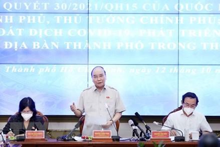 Chủ tịch nước Nguyễn Xuân Phúc: Kiểm soát tốt dịch bệnh là điều kiện tiên quyết phục hồi kinh tế