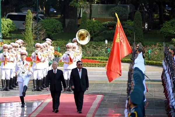 Hình ảnh lễ đón Tổng Bí thư, Chủ tịch nước Lào thăm chính thức Việt Nam