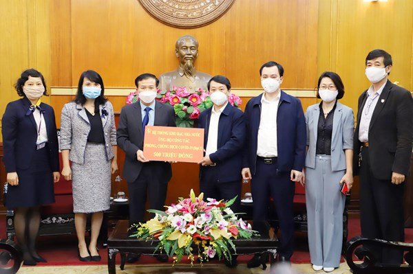 Kho bạc Nhà nước Việt Nam đồng hành cùng Mặt trận trong phòng, chống dịch Covid-19