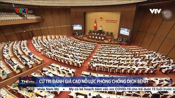 Chủ tịch Đỗ Văn Chiến trình bày báo cáo cử tri và nhân dân trước Quốc hội